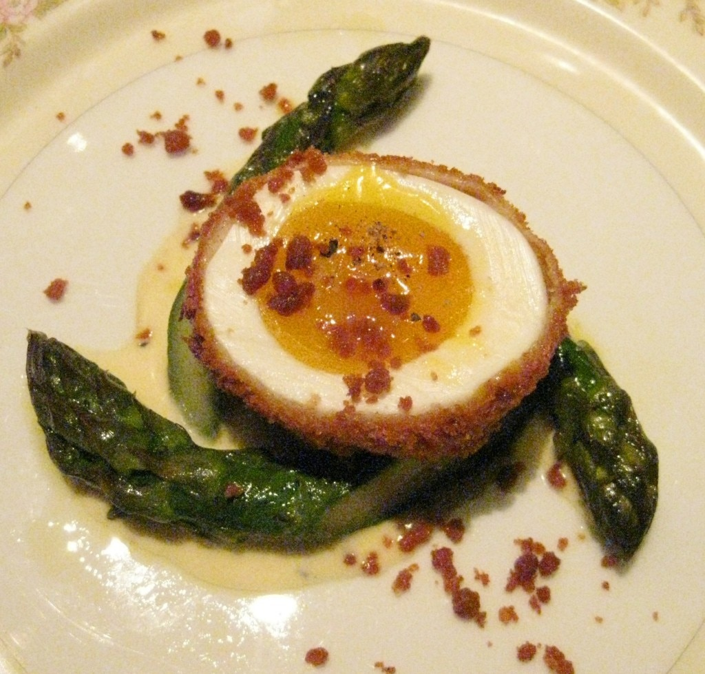Green-egg and ham: olive oil-poached Delta asparagus with a crispy soft-boiled egg, prosciutto bits and Cambozola crema