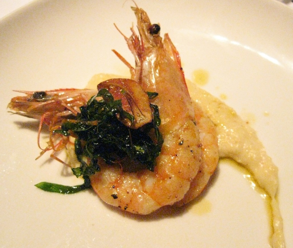 "Grilled ""angry"" prawns: crispy garlic, basil, orange, Calabrian chili dressing and heirloom Toscanelli white beans"