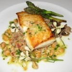 Wild Alaskan halibut, sautéed, with yellow foot chanterelles, farro grain, and Meyer lemon vinaigrette