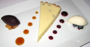 Meyer lemon tart with blueberry sorbet, candied macadamias and white chocolate ice cream