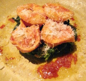 Nduja salami & lemon ricotta cappeletti: Calabrian broccoli rabe with tomato-pork and mosto oro olive oil
