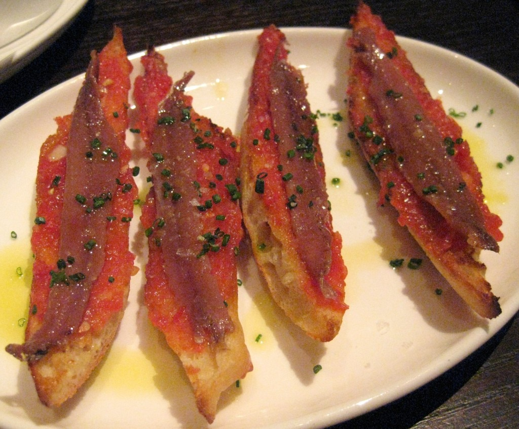 Pan con tomate y anchoas Españoles: toasted slices of rustic bread brushed with fresh tomato with Spanish anchovies