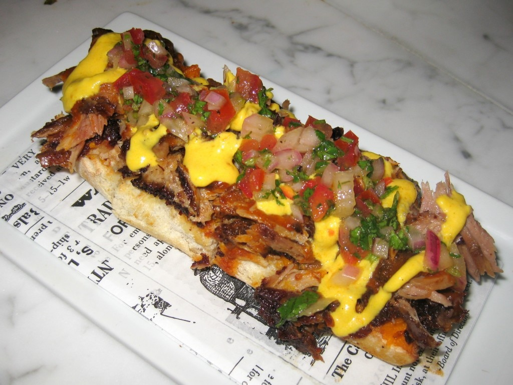 Chicharron de costillas: crispy pork ribs crostini, sweet potato puree, feta cheese sauce and salsa criolla