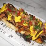 Chicharron de costillas: crispy pork ribs crostini, sweet potato puree, feta cheese sauce and salsa criolla