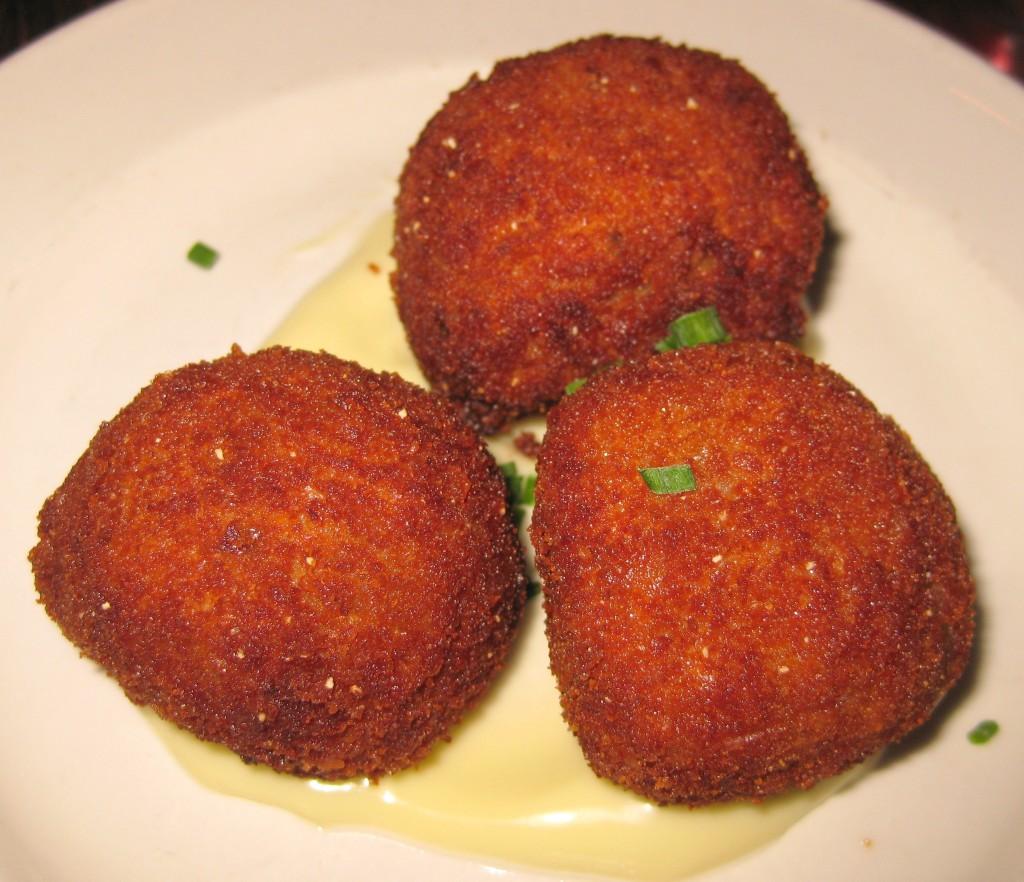 Croquetas de pollo y jamón: fried bechamel, caramelized onions, chicken, jamón serrano