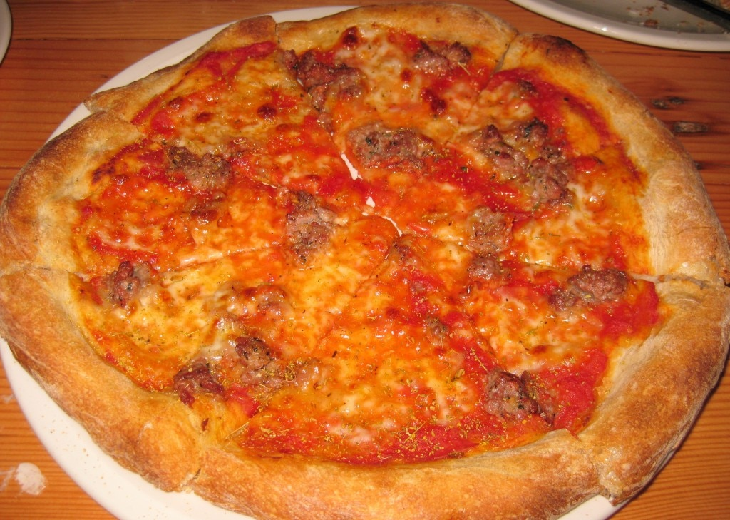 Housemade organic Italian sausage pizza: tomato, fresh mozzarella, hand-picked oregano and fennel pollen