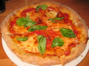 Margherita: tomato, fresh mozzarella, sweet basil and organic extra virgin olive oil