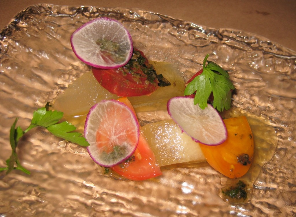 Heirloom melon and onion salad: tomato, hazelnuts and basil