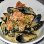 Mussels Dijonnaise: garlic, shallots, tomato confit, house mustard, tarragon and cream