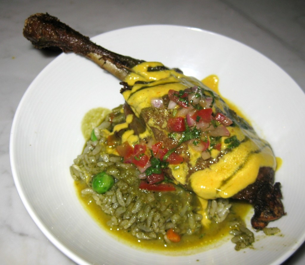 Seco de pato: duck leg confit, black beer sauce and cilantro rice