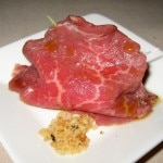 Beef carpaccio with caviar and extra virgin olive oil