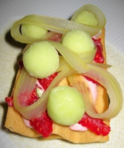 Raspberries atop a waffle with celery cream and sorbet