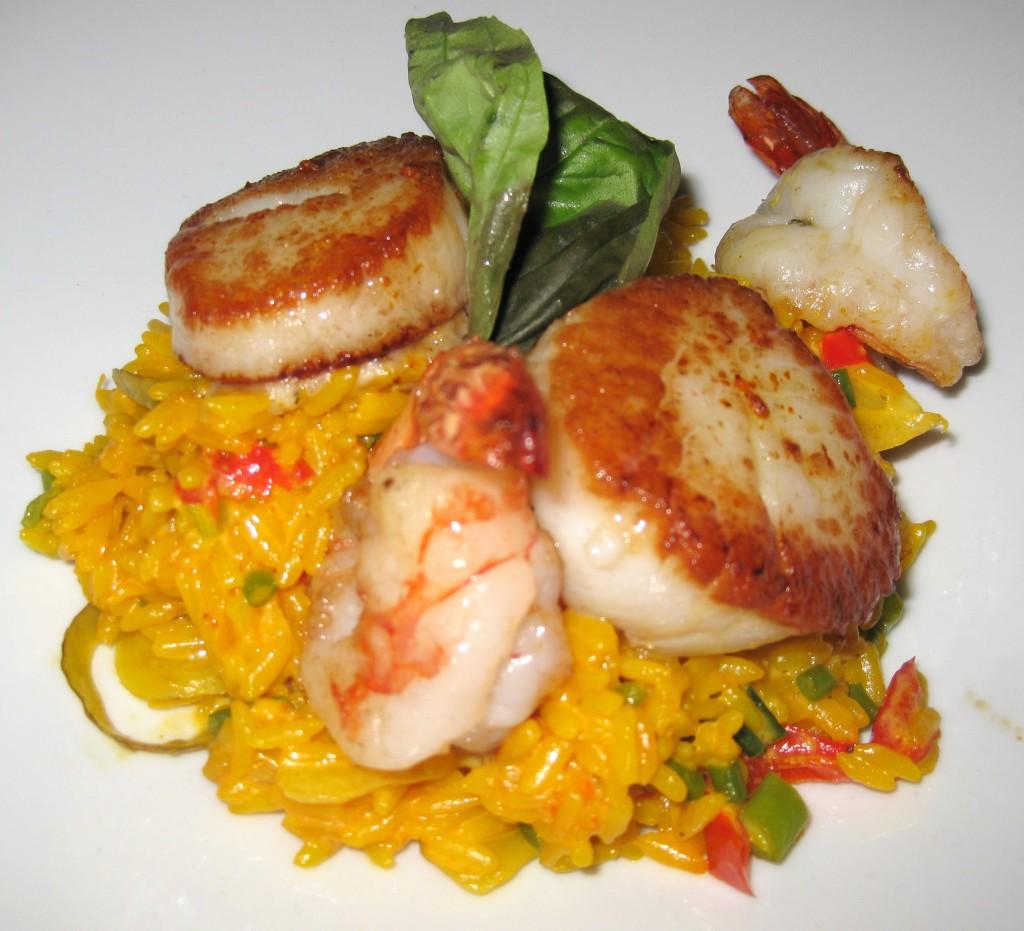 Paella del mar: black tiger shrimp, diver scallop, garden vegetable, artichoke tapenade, saffron rice pimentón and oregano hojiblanca olive oil