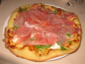 White pizza: prosciutto, burrata, arugula and truffle oil