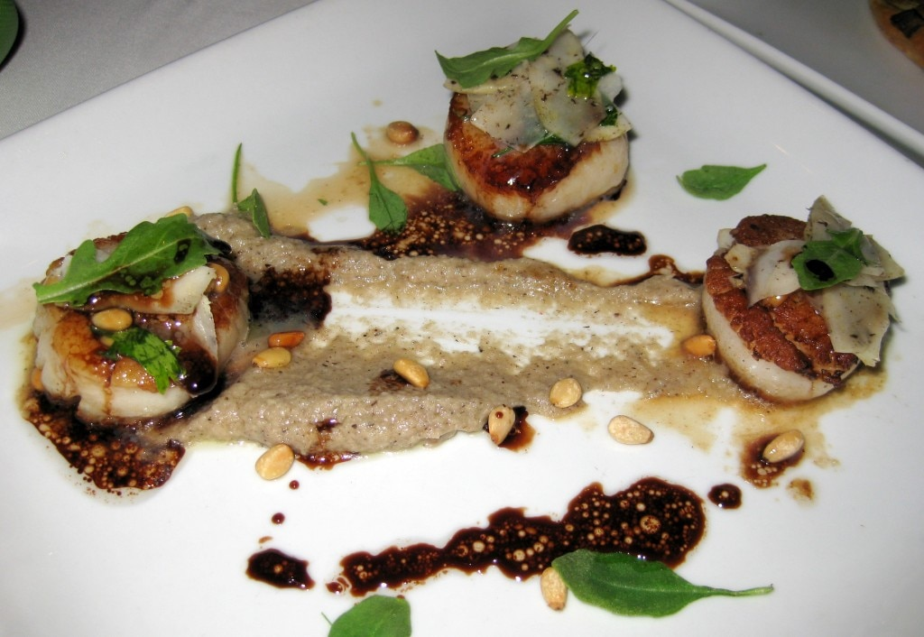 Sea scallops and truffle artichoke tapenade: seared sea scallops, truffle artichoke, arugula pine nuts with aged balsamic and white truffle olive oil