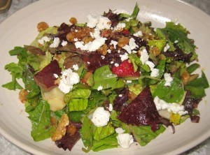 Spring chopped salad with snap peas, strawberries, walnuts, goat cheese and balsamic