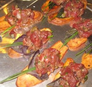 Filet mignon tartare served on a crispy fingerling chip with fresh thyme