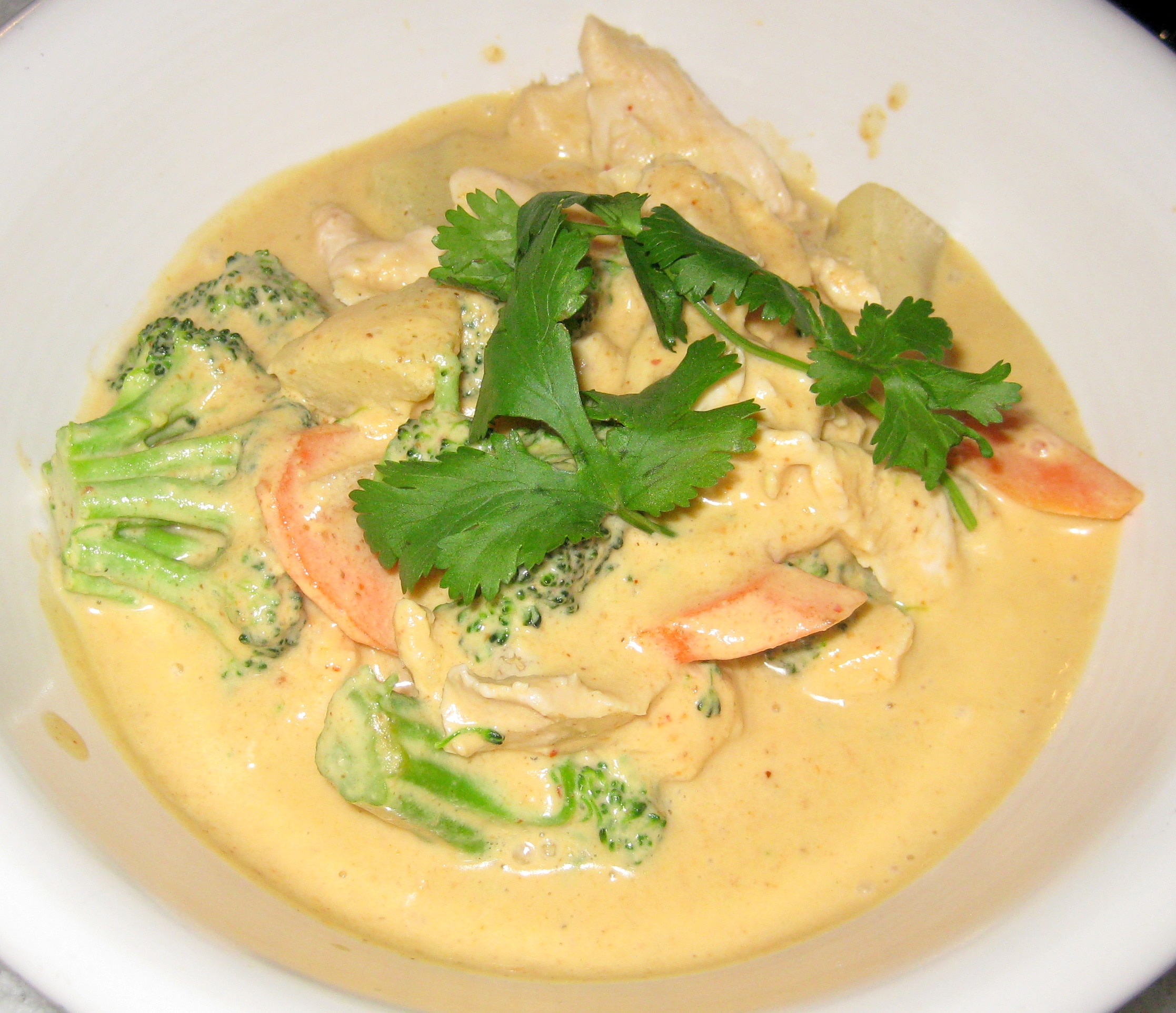 Panang curry with brown rice, potato, broccoli, ginger, carrot ...