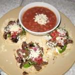 All natural steak tacos, avocado, Cotija cheese, tomatillo salsa, sour cream and Anasazi beans