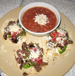 steak tacos 298x300 All natural steak tacos, avocado, Cotija cheese, tomatillo salsa, sour cream and Anasazi beans