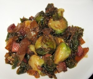 Fried Brussels sprouts with bacon and sweet and sour onions