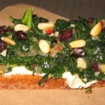 Crostini with kale, ricotta, pine nuts and currants