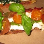 Crostini with tomato, pesto, ricotta, basil and balsamic