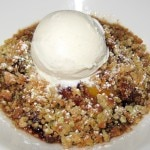 Market fruit cobbler with muffin streusel and vanilla ice cream