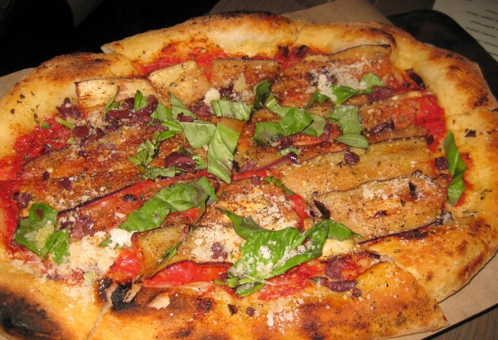Eggplant pizza with tomato, parmesan and oregano