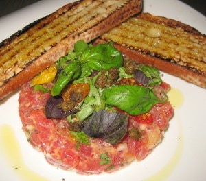 Tuna tartare with mustard, oven-roasted tomato and crostini