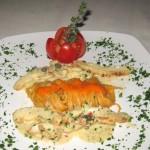 Calamari con Grappa: Sliced calamari steak with shallots and a dash of Italian grappa over Italian Barilla pasta