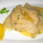 Ravioli Arragosta: Lobster and basil filled ravioli with a sauce of Japanese ginger and citrus