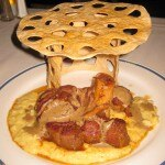Ossobuco Milanese: Braised bone-in veal shank served with locally farmed herbs over soft Italian polenta finished with porcini mushrooms