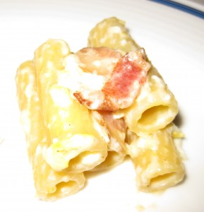 Rigatoni Carbonara: Large tube pasta tossed in a sauce of Grana Padano cheese, egg and sautéed bacon