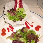 Contemporary Greens: Mesclun greens tossed with passion fruit vinaigrette