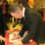 Thomas Keller signing the Hermès scarf A la Gloire de la Cuisine Française