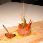 Tuna Tartare: Hawaiian ahi tuna, finely chopped and served with a mildly spiced dressing