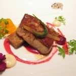 Seared Foie Gras with fuyu persimmon, parsnip cake, and cranberry reduction