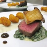 Steak & potatoes: celeriac creamed spinach, black garlic, bone marrow, truffled 'tater tots'