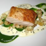 Pan-seared sturgeon with broccoli puree, cauliflower florets and caviar cream