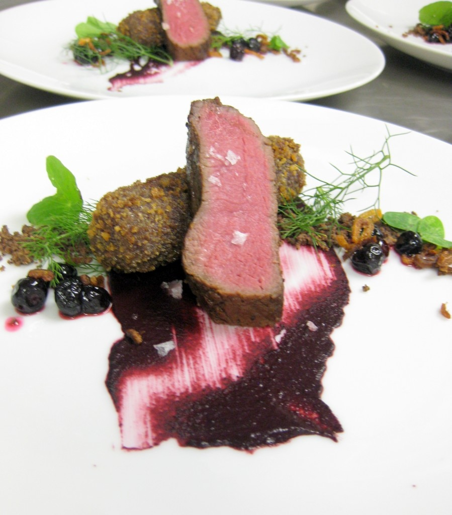 Venison neck and loin with coffee, huckleberry mustard, crispy shallot and forest herbs