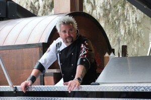 guy fieri 300x199 Guy Fieri helming the outdoor pizza oven