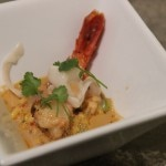 Michael Mina's paella risotto, saffron prawn broth and shaved lardo