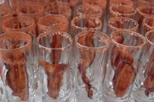 Shot glasses awaiting pork jus Bloody Marys