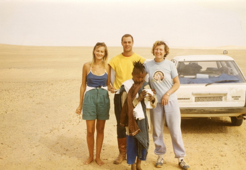 The Gayot family with a Touareg kid and Peugeot 505 in the Sahara Desert in 1981