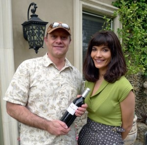 Alain Gayot receives a bottle of Mt. Brave 2008 Cabernet Sauvignon from Julia Jackson
