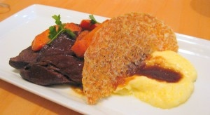 72-hour braised short rib with polenta and Syrah sauce