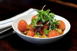 Patita, a pig trotter stew made with homemade chorizo, potatoes and cherry tomatoes at Picca restaurant