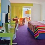 A colorful guest room at Saguaro Palm Springs in California