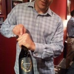 Chris Towt of Dunstan Wines uncorking another bottle